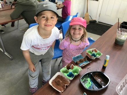 Boy and girl smiling doing crafts