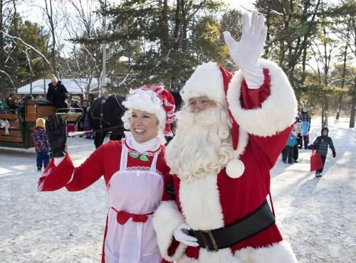 Santa and Mrs. Claus waving to onlookers at Christmas at Ken Reid
