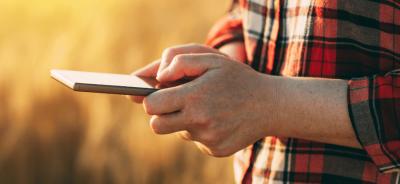 Farmer holding a smart phone